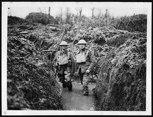 Trench with water up to knees